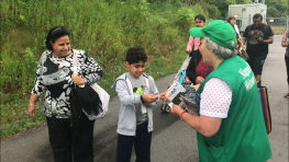 GO Transit customers being greeted by Niagara Falls volunteers after taking the seasonal service train from Toronto June 23, 2018