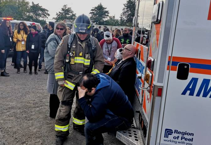 Toronto Fire and EMS assist actors portraying injured passengers during GO Transit emergency collision exercise Saturday, Sept. 22