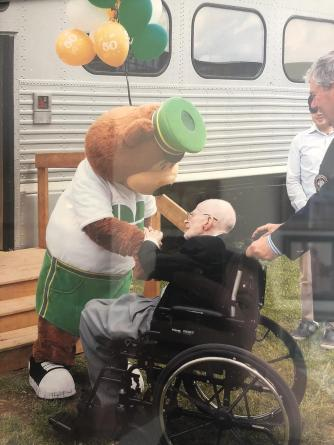 Norm Kuster greeted by GO Bear at GO's 50th anniversary celebration May 23rd, 2017