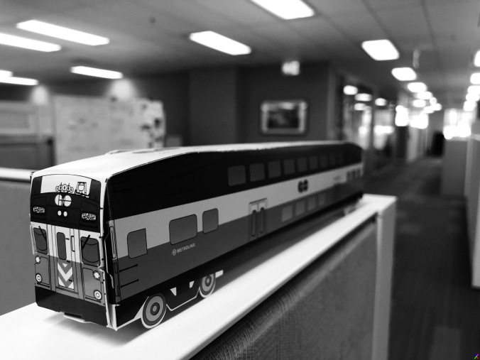 A cardboard Go train sits on a desk.