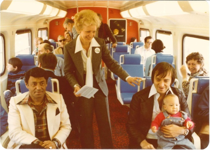 Passengers sit inside a GO train.