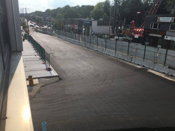 Smooth, new pavement is seen over top of construction, hidden below.