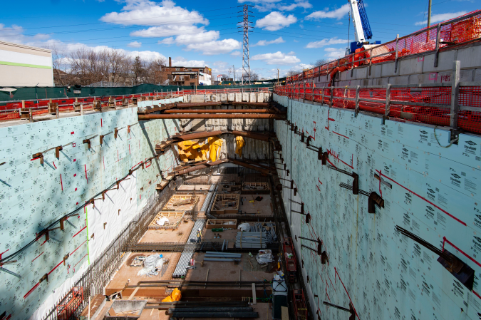 The large construction pit is shown. It includes concrete walls that are already lined with insulation.