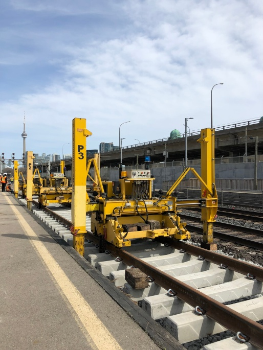 Heavy machinery laying down new tracks at Exhibition GO Station.