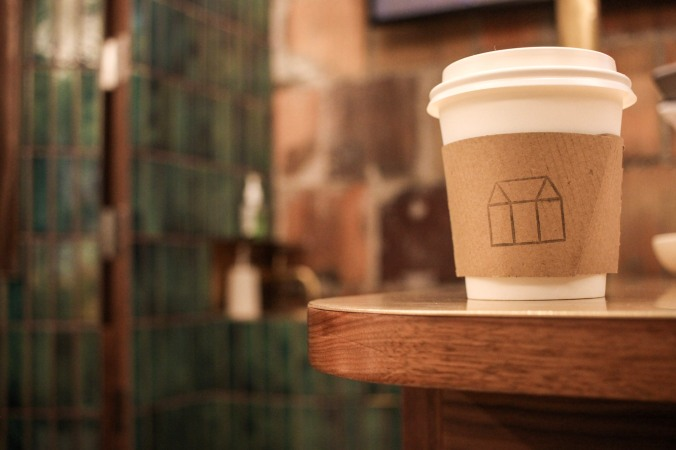 Photo of greenhouse juice company coffee cup