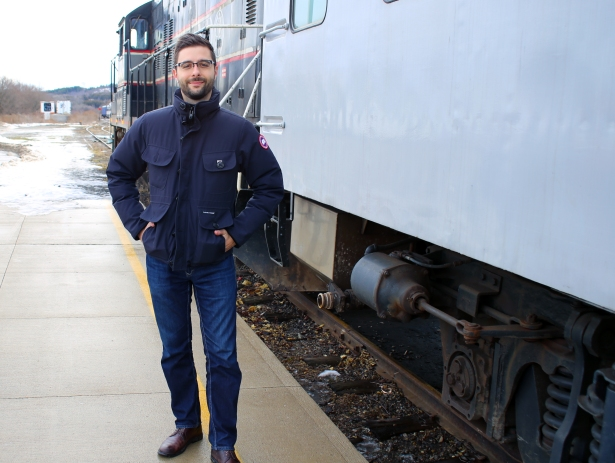 Christopher Balestri poses with a train