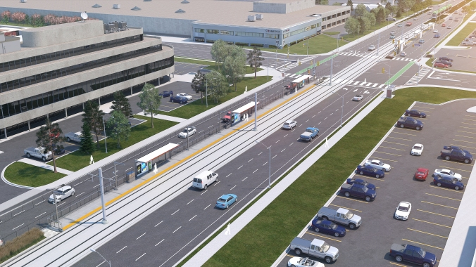 Looking down at an artist concept of the Golden Mile stop, cars continue on either side of the Golden Mile stop.
