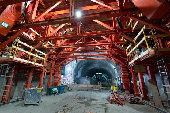 Large metal sections are built inside a tunnel.