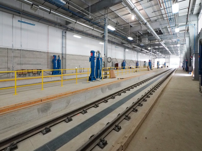 A photo of the Eglinton Crosstown LRT trainwash inside the maintenance facility.