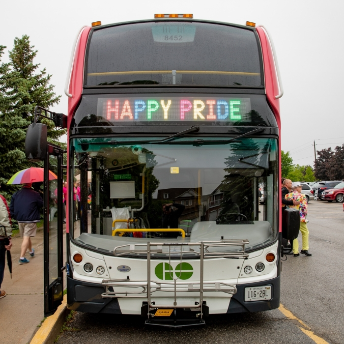 The front of a GO bus is seen, with 'Happy Pride' in the destination sign.