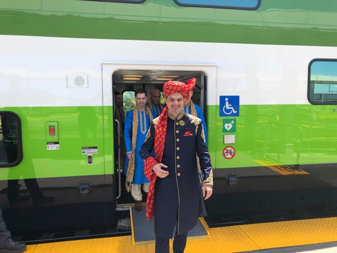 Chris Drew, dressed in his finest, exits a GO train.