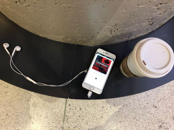 A coffee and phone are seen on a seat inside Union Station.