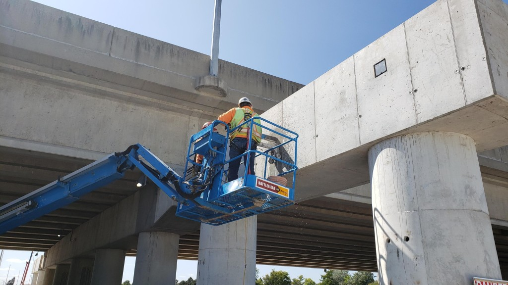 A worker inspects concrete.