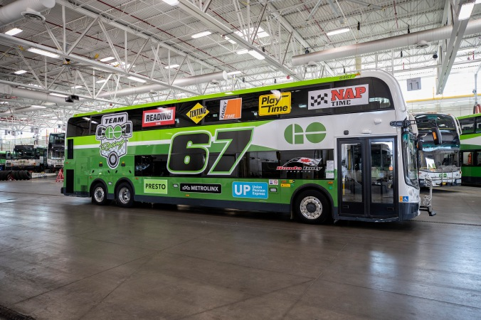 photo of the double decker GO bus with Honda Indy decals
