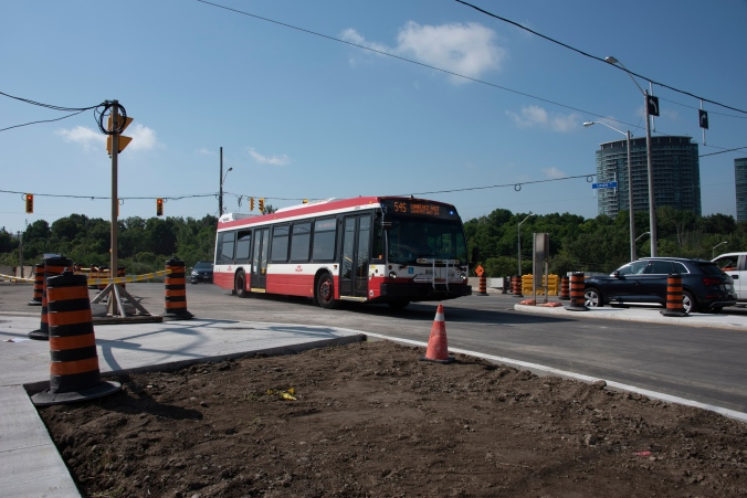 A TTC bus travels through the Leslie Street intersection.
