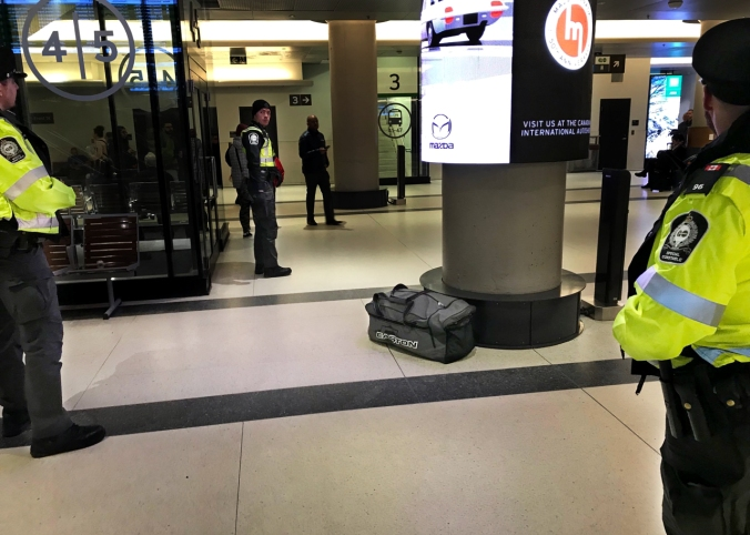 Transit officers stand near a suspicious bag inside Union Station.