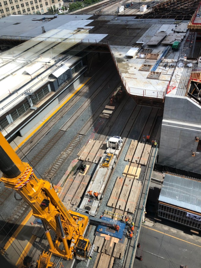 A view from high above a crane, as it looks down on crews.