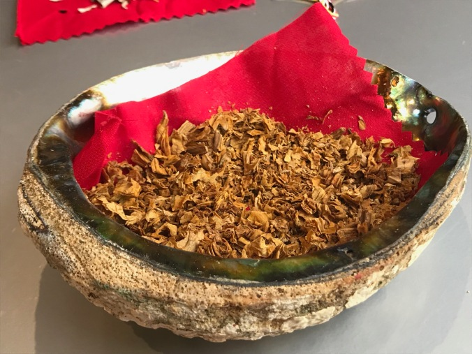 A bowl of tobacco rests on a table.