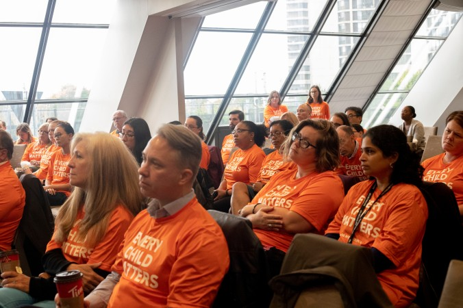 Metrolinx employees listen to speakers at a Sept. 30, 2019, event.