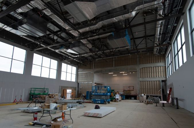 Inside the empty building, walls and ceiling are new and primed.