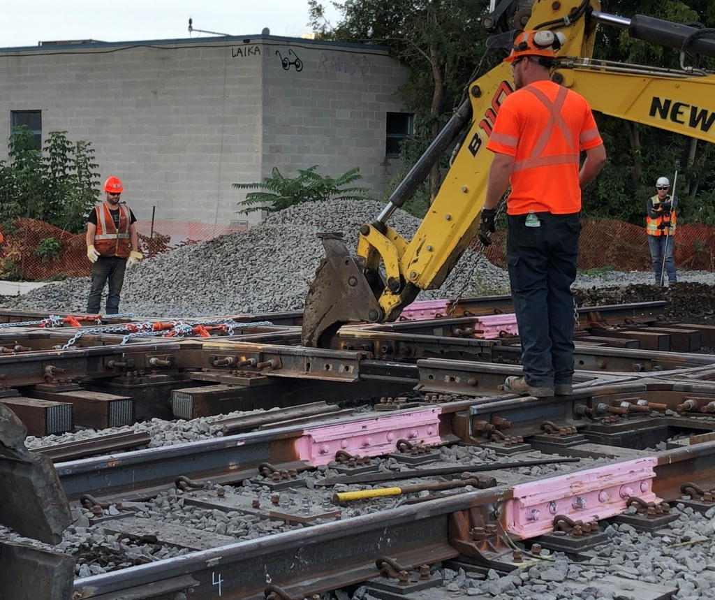 Crews move a section of track.