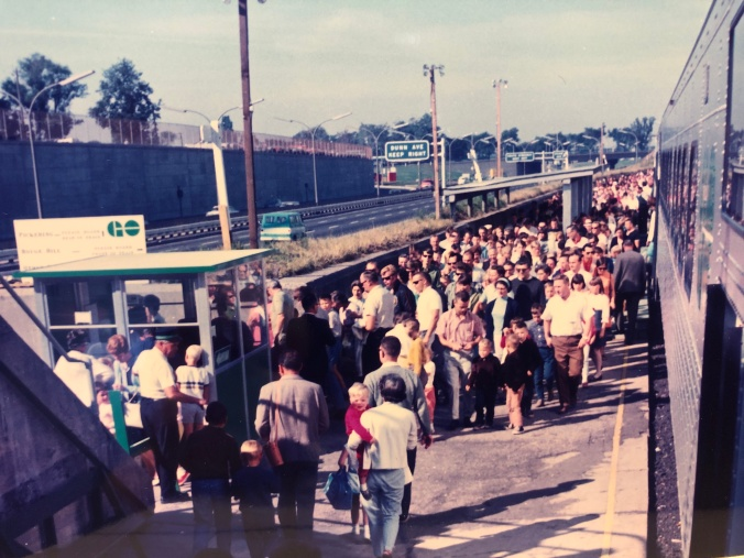 Crowds gather on a GO platform.