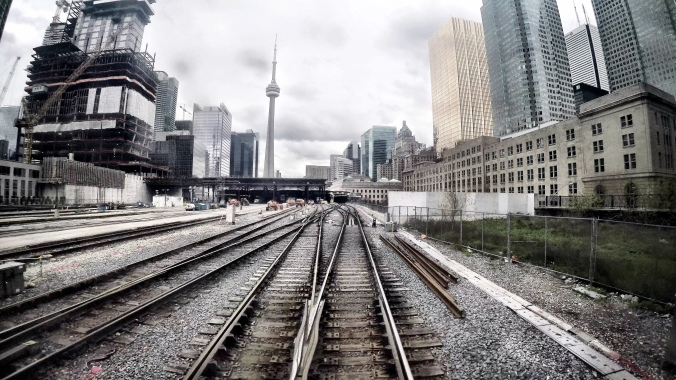 Image shows rail lines with no traffic. The lines stretch into Toronto's Union Station.