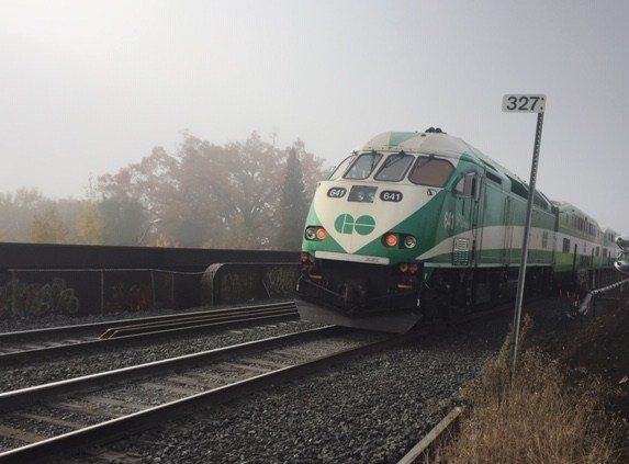 A GO train moves across a repaired bridge.