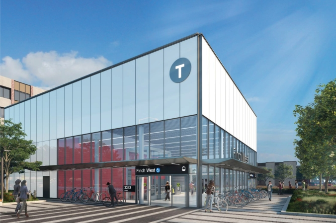 Image shows the outside of a bright, white and glass transit station, as customers walk in and someone gets a bike.
