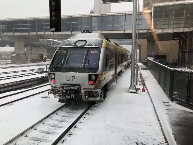 Image shows an UP Express train pulling out of the Union Station platform.