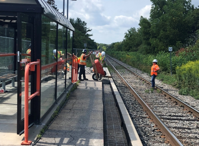 Crews are seen working on the edge of a platform.