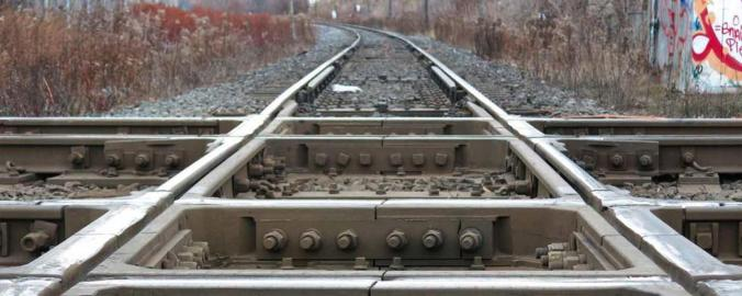 Image shows two rail tracks, crossing one another.