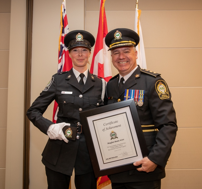 Meaghan Benini pictured with Transit Safety Director Bill Grodzinski at her graduation ceremony