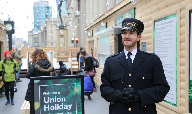 Photo of Bruce Caboose, the porter of the Union Station holiday skating rink with the rink in the background