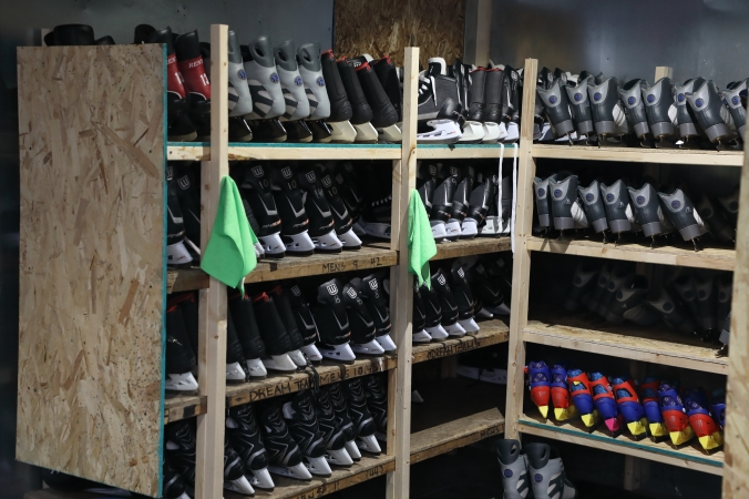 Ice skates on shelves, ready to be rented
