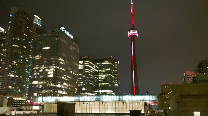 Image shows Union Station at night, with the CN Tower behind.