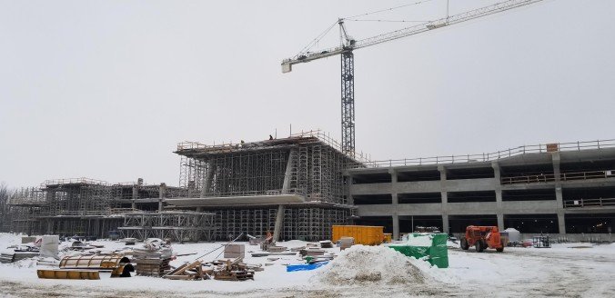 Image shows concrete and steel used for a large parking structure.