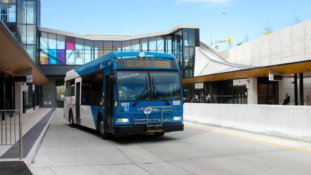 A Mississauga Transit MiWay bus departs from a Mississauga BRT station