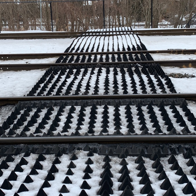 A photo of the rubber safety panels laying next to the tracks