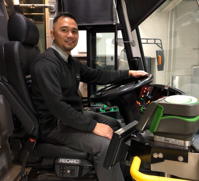 Photo of GO Transit bus driver driver Bryan Jeresano sitting in his GO bus driver seat.
