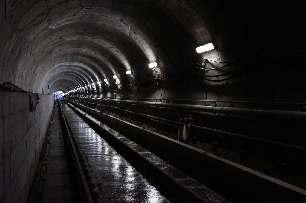 Image shows tracks inside a dark tunnel.