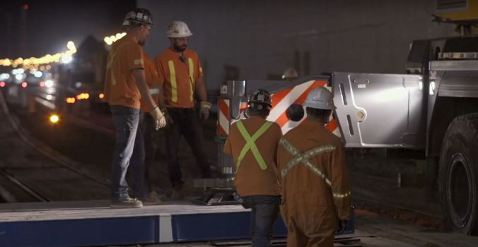 An image of crews working on the bridge.