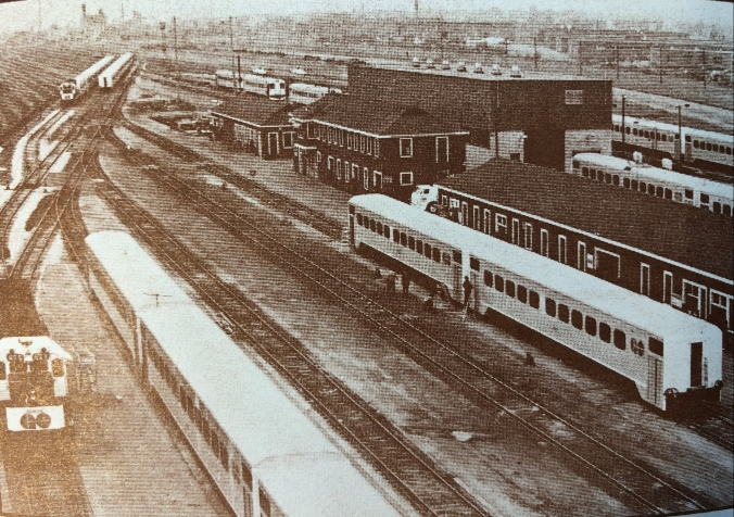 Historical image shows trains sitting in the rail yard.