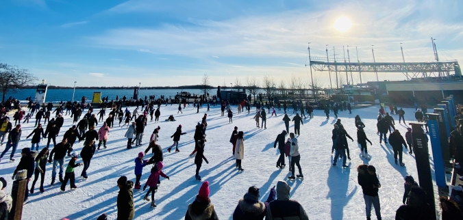 Skaters make their way across ice at the rink at Harbourfront.