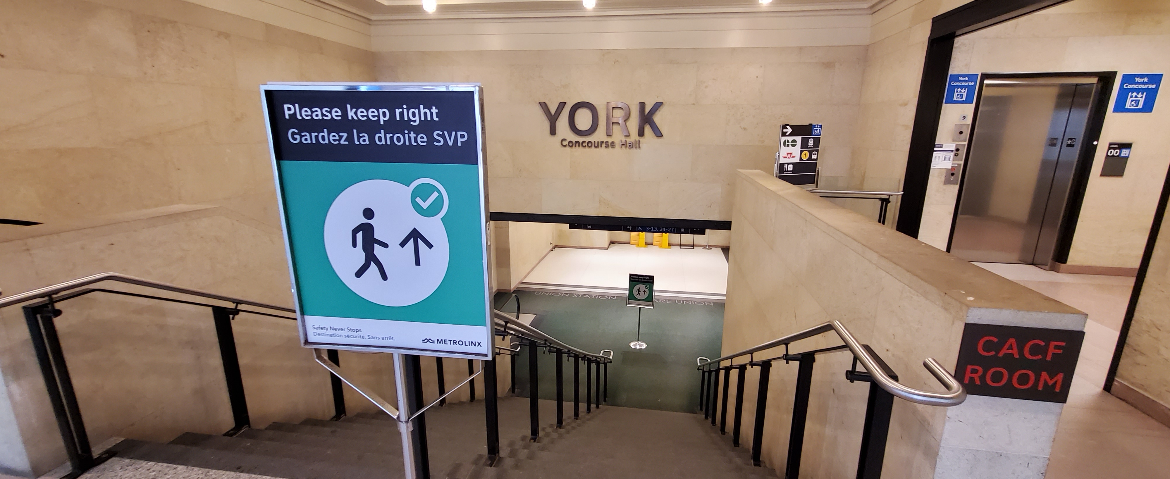 Image shows a sign that tells people on the stairs to stay to the right.
