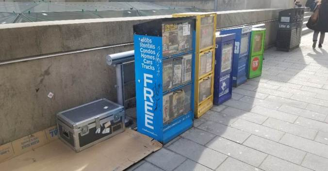 Image shows a large box beside newspaper boxes.
