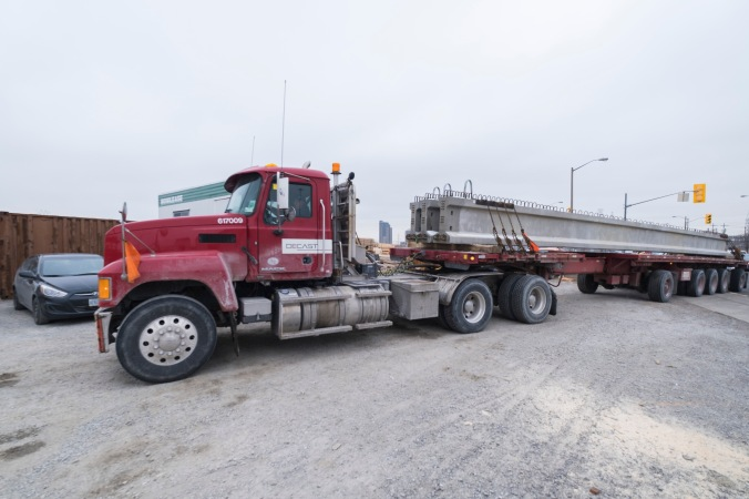 A truck delivers a girder in this file image.