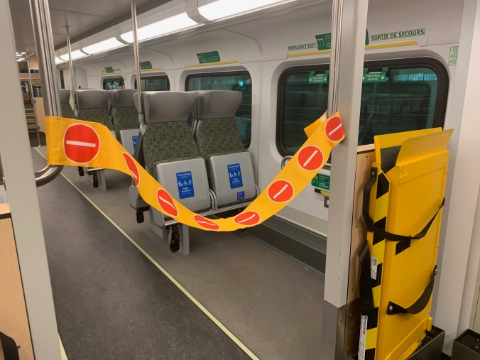 Image shows yellow velcro strip seperating staff from passengers.