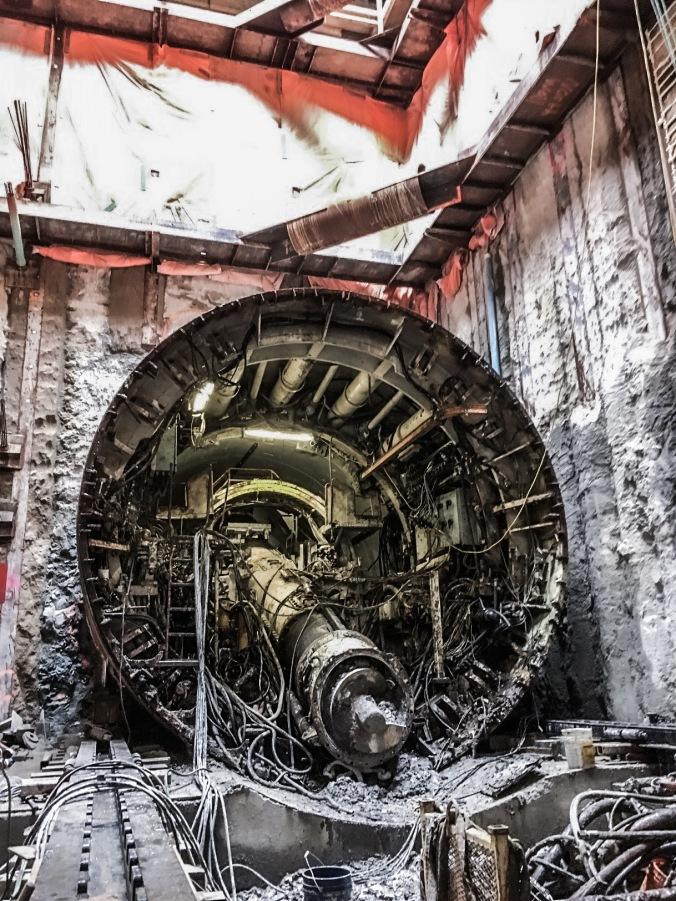 Image shows the inside of a giant machine. Lots of dirty metal.