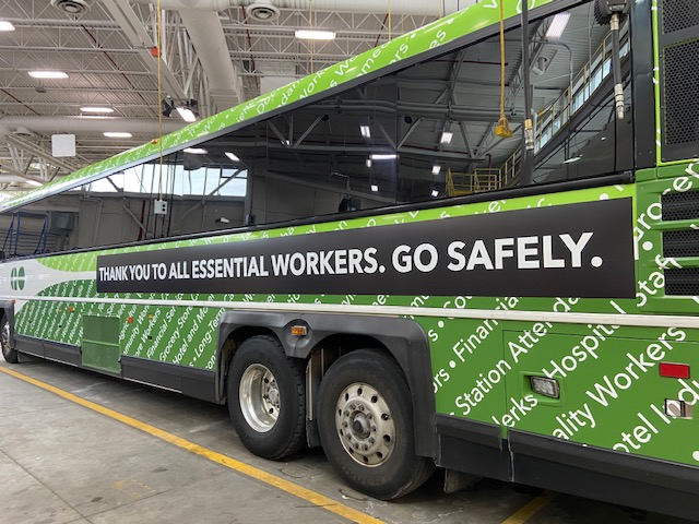 A GO bus features a sign that thanks essential workers.